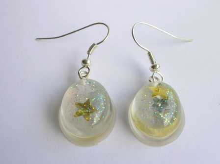 Silver/Gold confetti star earrings (small oval)
